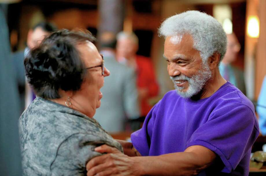 State Sen. Ernie Chambers of Omaha celebrates with state Sen. Kathy Campbell of Lincoln after the Legislature voted 30-19 to override the veto. Photo: Nati Harnik /Associated Press / AP