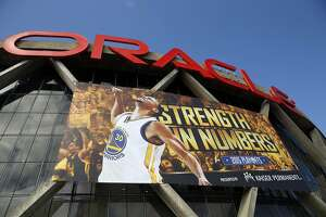 A mural of Golden State Warriors' Stephen Curry adorns the exterior of Oracle Arena before Game 5 of NBA Playoffs' Western Conference Finals in Oakland, Calif., on Wednesday, May 27, 2015.