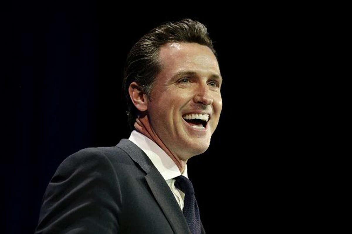 Newsom speaking, in smiley mode