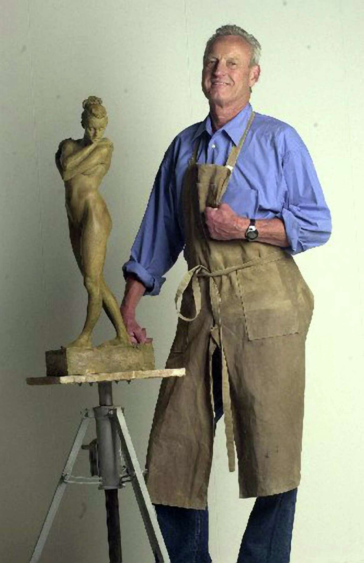 Bruce Wolfe works on a small sculpture