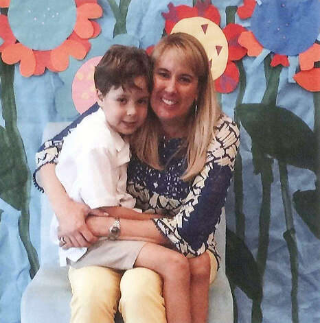 This undated photo provided by the Hays County Sheriff's Office shows Michelle Charba, seated, with William Charba, 6. Both have been missing from Wimberley, Texas since Sunday, May 24, 2015. Crews resumed the search Wednesday, May 27 for people missing and presumed dead after the swollen Blanco River surged through the small tourist town of Wimberley over the weekend.  (Hays County Sheriff's Office, via AP) ORG XMIT: TXKJ101 / Hays County Sheriff's Office