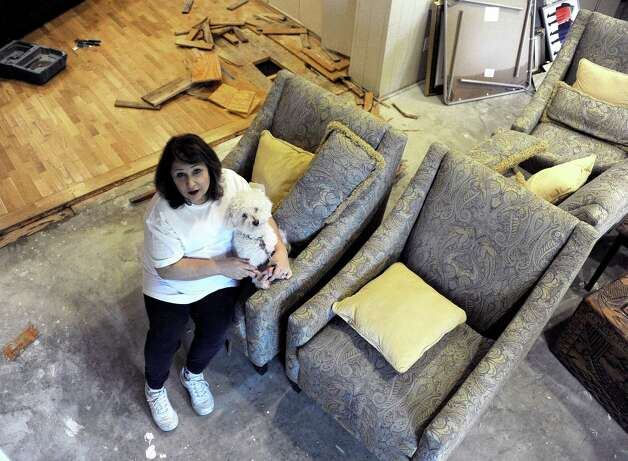 Randi Rosenkrantz holds her dog Sugar as she talks about the flood damage to her home Wednesday, May 27, 2015, in Houston. Heavy rains have caused flooding and closure of sections of highways in the Houston area and across Texas. (AP Photo/Pat Sullivan) ORG XMIT: TXPS101 Photo: Pat Sullivan / AP
