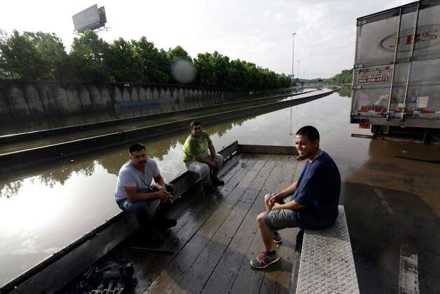 Stranded motorists wait for floodwaters to recede on Interstate 45 after heavy rains overnight in Houston, Tuesday, May 26, 2015. Several major highways are closed in the Houston area due to high water. (AP Photo/David J. Phillip) ORG XMIT: TXDP104 Photo: David J. Phillip / AP