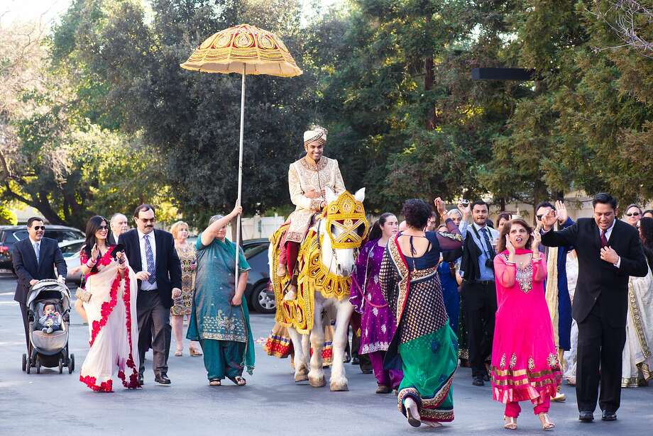 Abe Gupta rides a horse into the wedding on a horse, per tradition. He and bride Vaishali Bhatnagar got married during a six-day affair, with the traditional Hindu ceremony taking place at San Jose's Hayes Mansion. Photo: Janet Love Photography