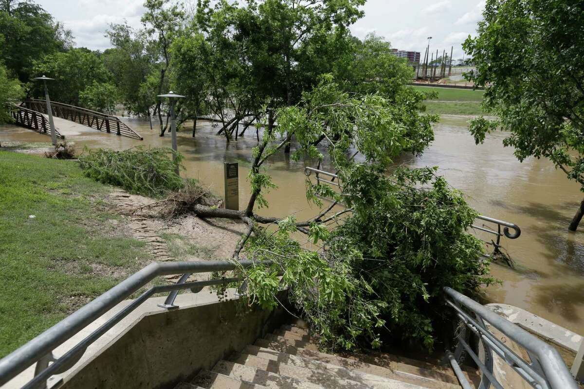 Mud and storm debris cover pathways along Buffalo Bayou Park near Sabine St. Wednesday, May 27, 2015, in Houston.