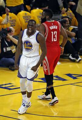 Golden State Warriors' Draymond Green celebrates a basket against Houston Rockets' James Harden in 1st quarter in Game 5 of NBA Playoffs' Western Conference Finals at Oracle Arena in Oakland, Calif., on Wednesday, May 27, 2015.