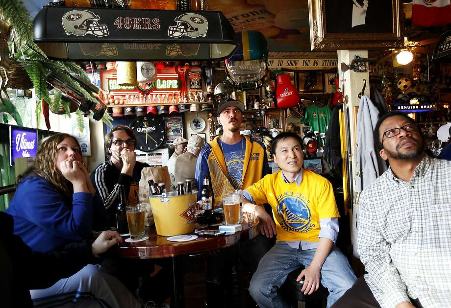 From left, Krissy Eddy, Martin Thompson, Adam Eddy, Don Lo and Qunitious Perkins watch the Warriors at 19th Street Station in Oakland, Calif., on Wednesday, May 27, 2015. Photo: Sarah Rice, Special To The Chronicle