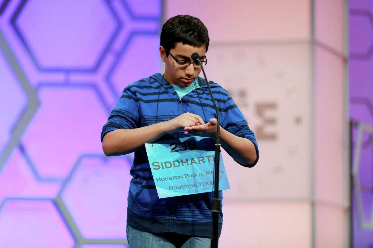 At left, Siddharth Krishnakumar, 13, remembers how to spell words by writing them on his hand. Shobha Dasari, 14, is competing the Scripps National Spelling Bee in Washington, D.C., for the last time.
