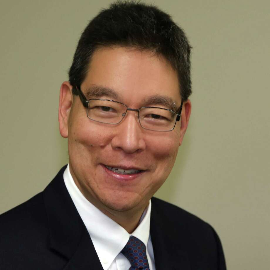 Peter Wang, a former Schlumberger employee, has found work as a consultant after being laid off. Photo: Courtesy Photo