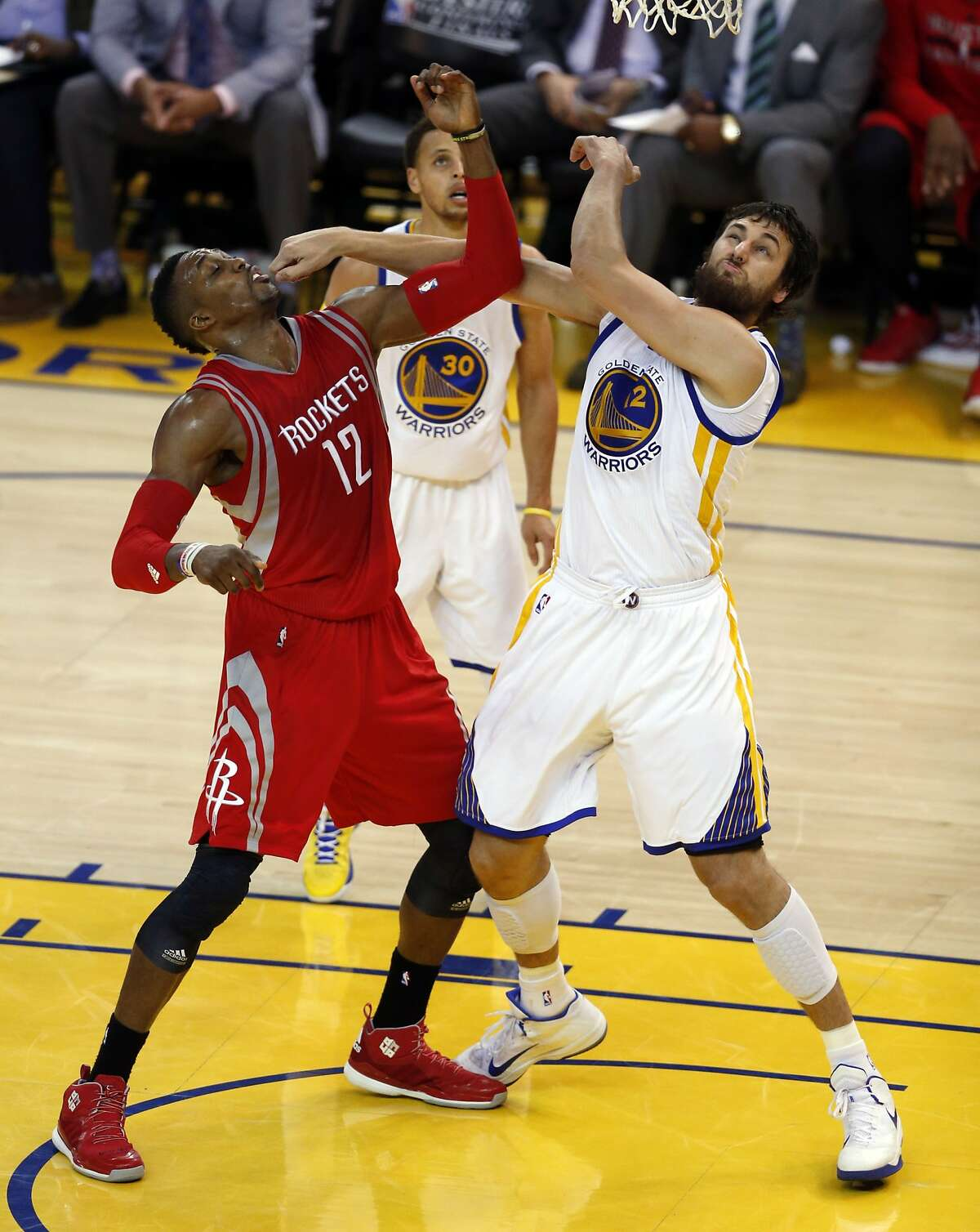 Golden State Warriors' Andrew Bogut battles Houston Rockets' Dwight Howard in 2nd quarter in Game 5 of NBA Playoffs' Western Conference Finals at Oracle Arena in Oakland, Calif., on Wednesday, May 27, 2015.