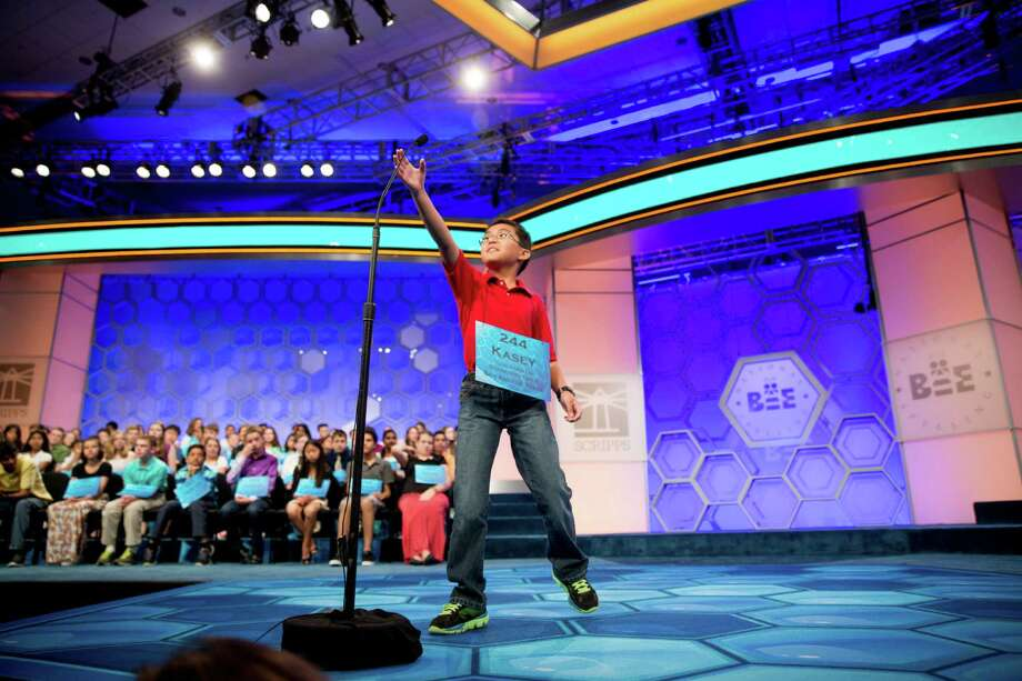 Kasey Torres, 10, grabs the microphone during the 2015 Scripps National Spelling Bee in Oxon Hill, Md. It can be bent but not raised or lowered. Photo: Andrew Harnik /Associated Press / AP