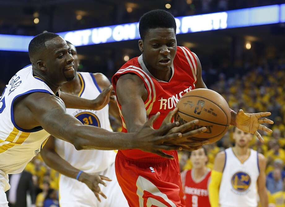Golden State Warriors forward Draymond Green (23) and Houston Rockets center Clint Capela (15) fight for a rebound during the first quarter of Game 5 of the NBA Western Conference finals at Oracle on May 27, 2015. Photo: Houston Chronicle