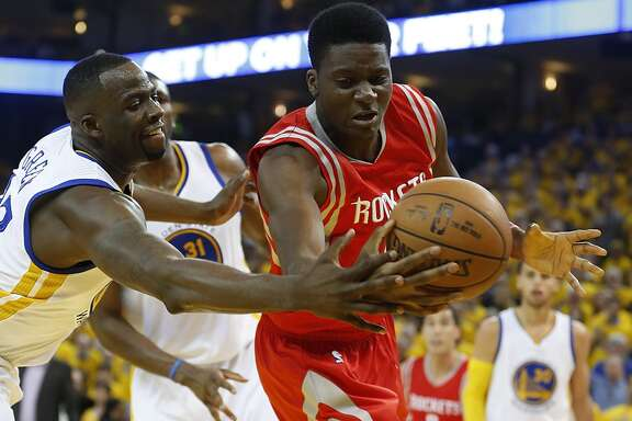 Golden State Warriors forward Draymond Green (23) and Houston Rockets center Clint Capela (15) fight for a rebound during the first quarter of Game 5 of the NBA Western Conference finals at Oracle Arena Wednesday, May 27, 2015, in Oakland.  ( James Nielsen / Houston Chronicle )