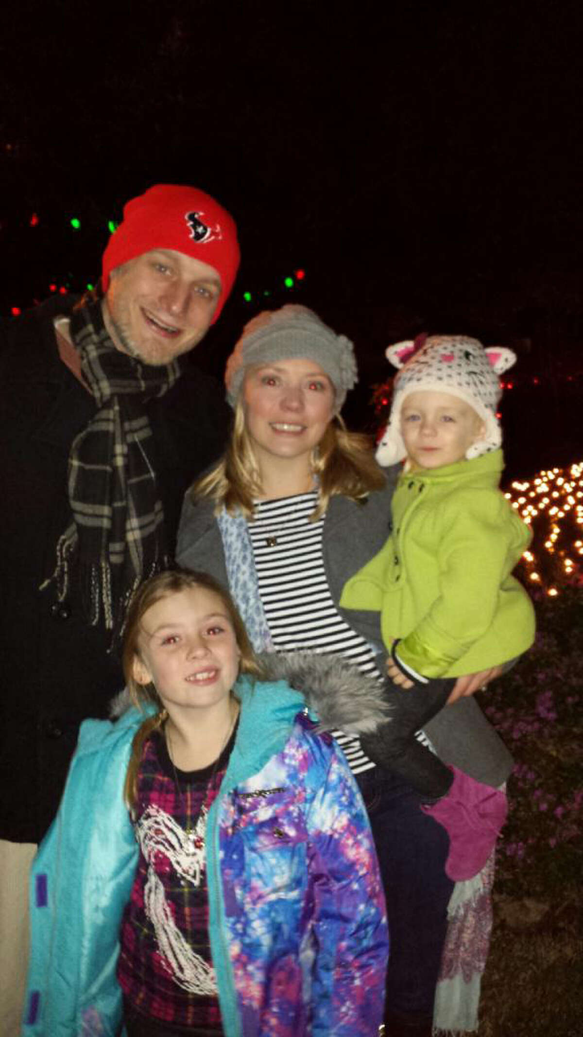 Christopher Kirby, 35, pictured with his family, was found in his car after it had been towed.