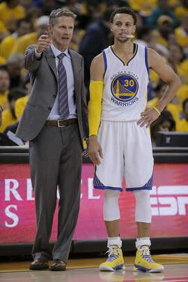 Golden State Warriors' Coach Steve Kerr and Stephen Curry are seen in the second period during Game 5 of the Western Conference Finals on Wednesday, May 27, 2015 in Oakland, Calif.