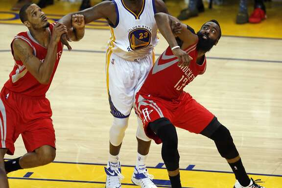Golden State Warriors' Draymond Green battles for rebound position against Houston Rockets' James Harden and Trevor Arriza in 3rd quarter in Game 5 of NBA Playoffs' Western Conference Finals at Oracle Arena in Oakland, Calif., on Wednesday, May 27, 2015.
