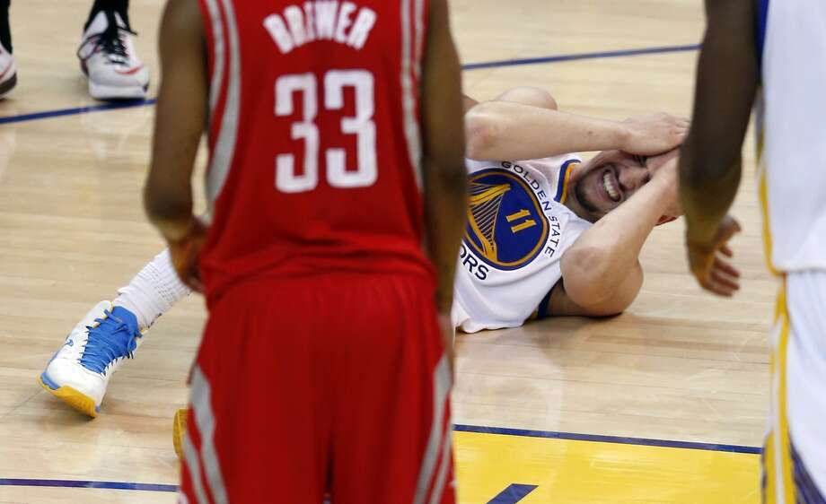 Golden State Warriors' Klay Thompson reacts to his 4th quarter injury against a Houston Rockets in Game 5 of NBA Playoffs' Western Conference Finals at Oracle Arena in Oakland, Calif., on Wednesday, May 27, 2015. Photo: Scott Strazzante, The Chronicle