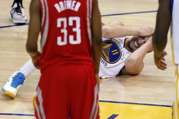 Golden State Warriors' Klay Thompson reacts to his 4th quarter injury against a Houston Rockets in Game 5 of NBA Playoffs' Western Conference Finals at Oracle Arena in Oakland, Calif., on Wednesday, May 27, 2015.
