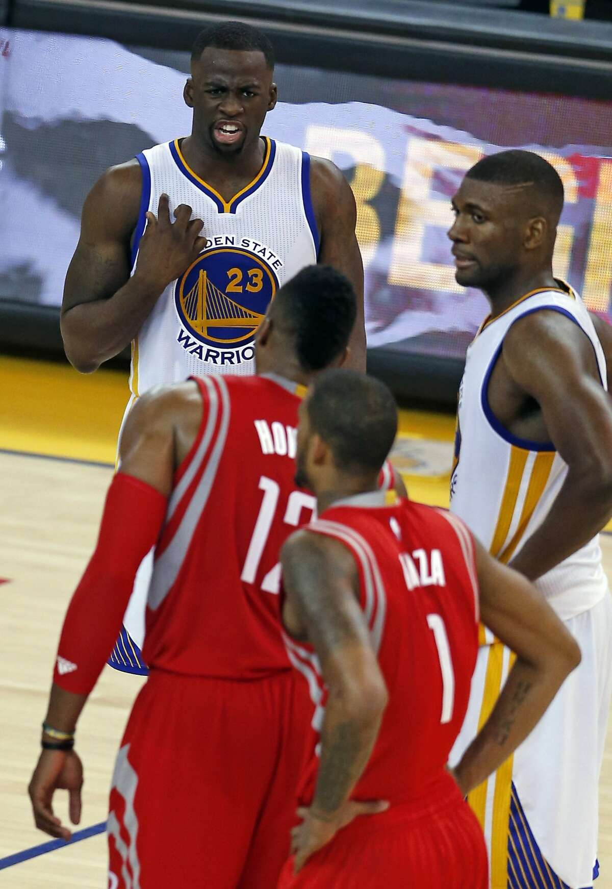 Golden State Warriors' Draymond Green has words for Houston Rockets' Dwight Howard after Howard fouled Andre Iguodala in 4th quarter in Game 5 of NBA Playoffs' Western Conference Finals at Oracle Arena in Oakland, Calif., on Wednesday, May 27, 2015.