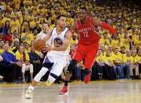 OAKLAND, CA - MAY 27:  Stephen Curry #30 of the Golden State Warriors drives on Dwight Howard #12 of the Houston Rockets in the second half during game five of the Western Conference Finals of the 2015 NBA Playoffs at ORACLE Arena on May 27, 2015 in Oakland, California. NOTE TO USER: User expressly acknowledges and agrees that, by downloading and or using this photograph, user is consenting to the terms and conditions of Getty Images License Agreement.  (Photo by Ezra Shaw/Getty Images) ORG XMIT: 554941197