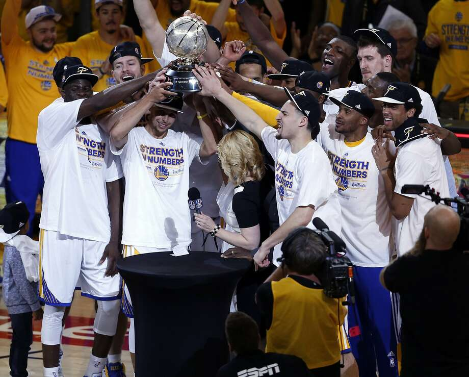 Golden State Warriors' Stephen Curry and teammates hold Western Conference trophy after defeating Houston Rockets 104-90 in Game 5 of NBA Playoffs' Western Conference Finals at Oracle Arena in Oakland, Calif., on Wednesday, May 27, 2015. Photo: Scott Strazzante, The Chronicle