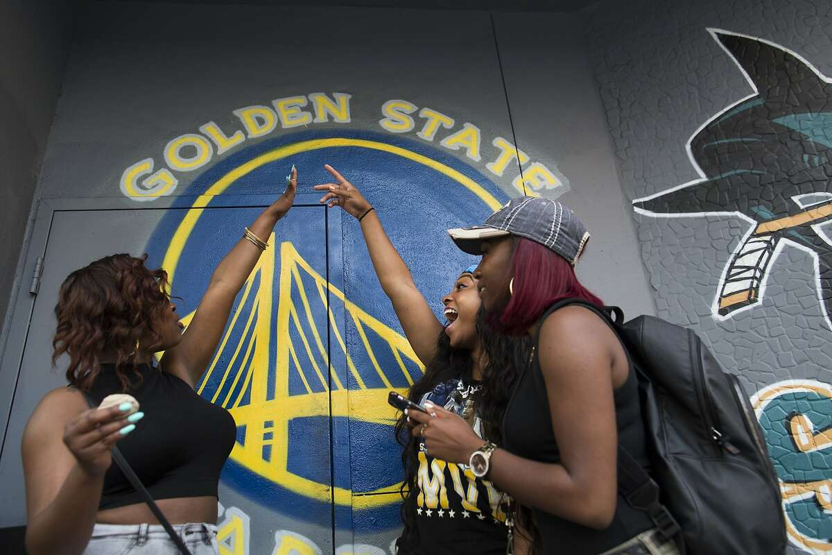 June Fairley, Brittany Flentroy and Arianna Ford hang outside Halftime Sports Bar as the Golden State Warriors play the Houston Rockets in Game 5 in Oakland, Calif. on Wednesday, May 27, 2015. The Warriors beat the Rockets 104-90.