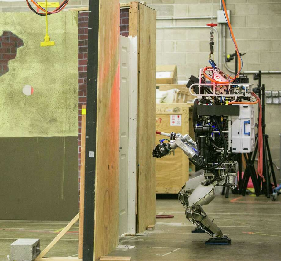 In Pennsauken, N.J., Lockheed Martin engineers design a robot for a Pentagon competition in June. The Pentagon has invested nearly $100 million into developing robots that could head into disaster zones off limits to humans. Photo: Dakota Fine /Washington Post / THE WASHINGTON POST
