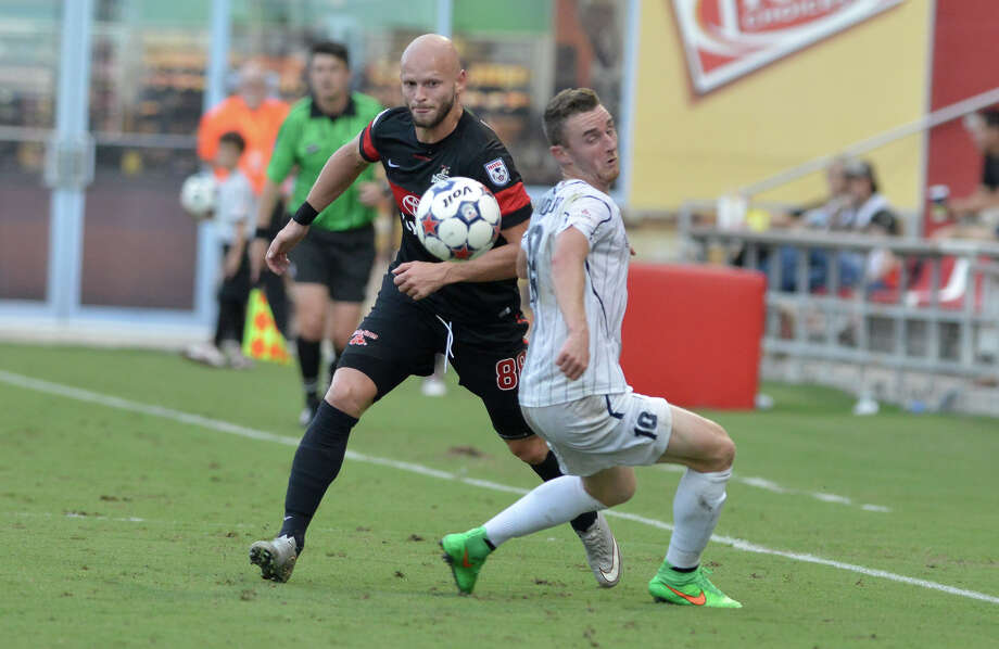 The Scorpions' Zourab Tsiskaridze (left) battles Austin's Mozzi Gyorio for the ball during the teams' U.S. Open Cup match at Toyota Field. The Aztex advanced to face the Houston Dynamo. Photo: Robin Jerstad / San Antonio Express-News