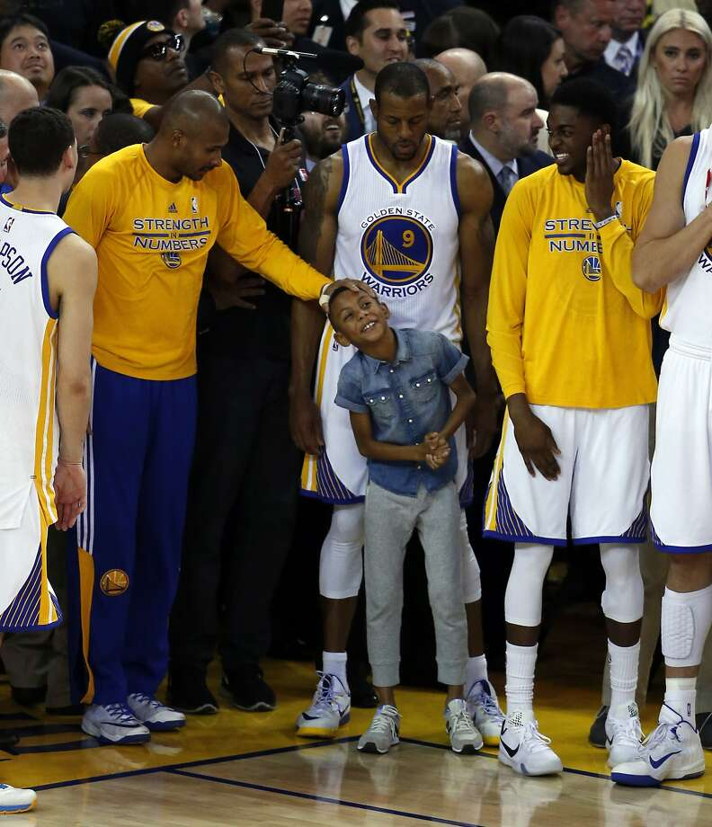 The son of Golden State Warriors' Andre Iguodala enjoys final minute of 104-90 win over Houston Rockets in Game 5 of NBA Playoffs' Western Conference Finals at Oracle Arena in Oakland, Calif., on Wednesday, May 27, 2015. Photo: Scott Strazzante, The Chronicle