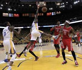 Harrison Barnes (40) dunks in the second half of Game 5 of the NBA Western Conference Final at Oracle Arena in Oakland, Calif., on Wednesday, May 27, 2015. The Warriors defeated the Rockets 104-90 to advance to the NBA Finals against the Cleveland Cavaliers.