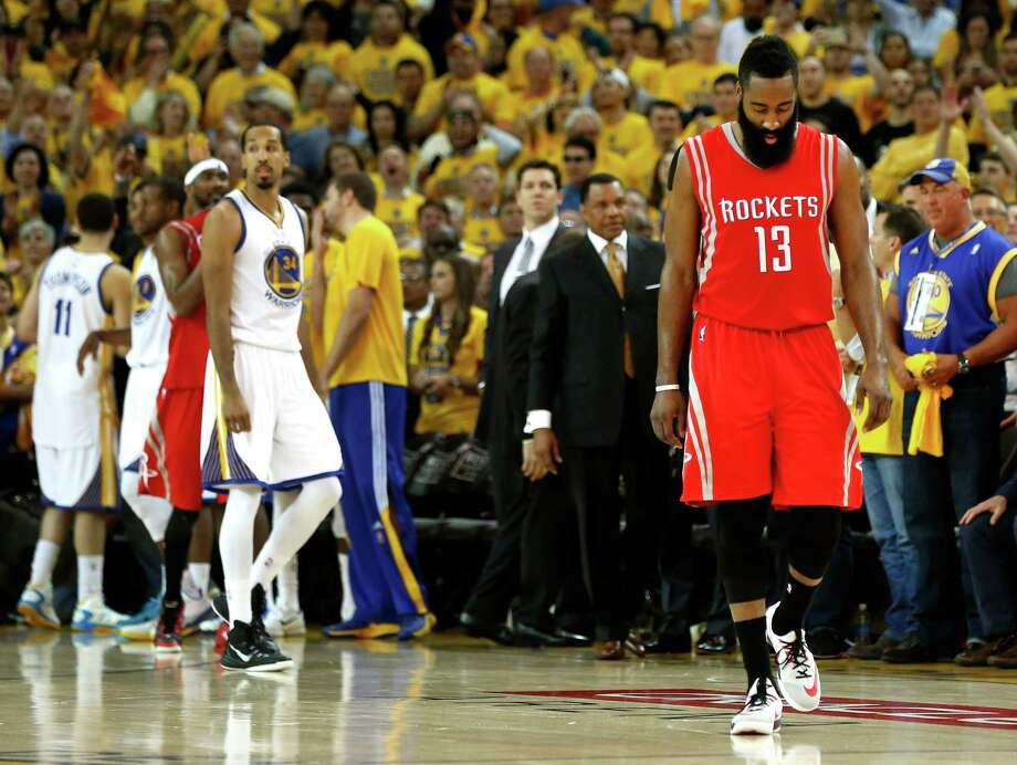Houston Rockets guard James Harden (13) walks up the court near the end of the fourth quarter of Game 5 of the NBA Western Conference finals against the Golden State Warriors at Oracle Arena Wednesday, May 27, 2015, in Oakland.  ( James Nielsen / Houston Chronicle ) Photo: James Nielsen, Staff / © 2015  Houston Chronicle