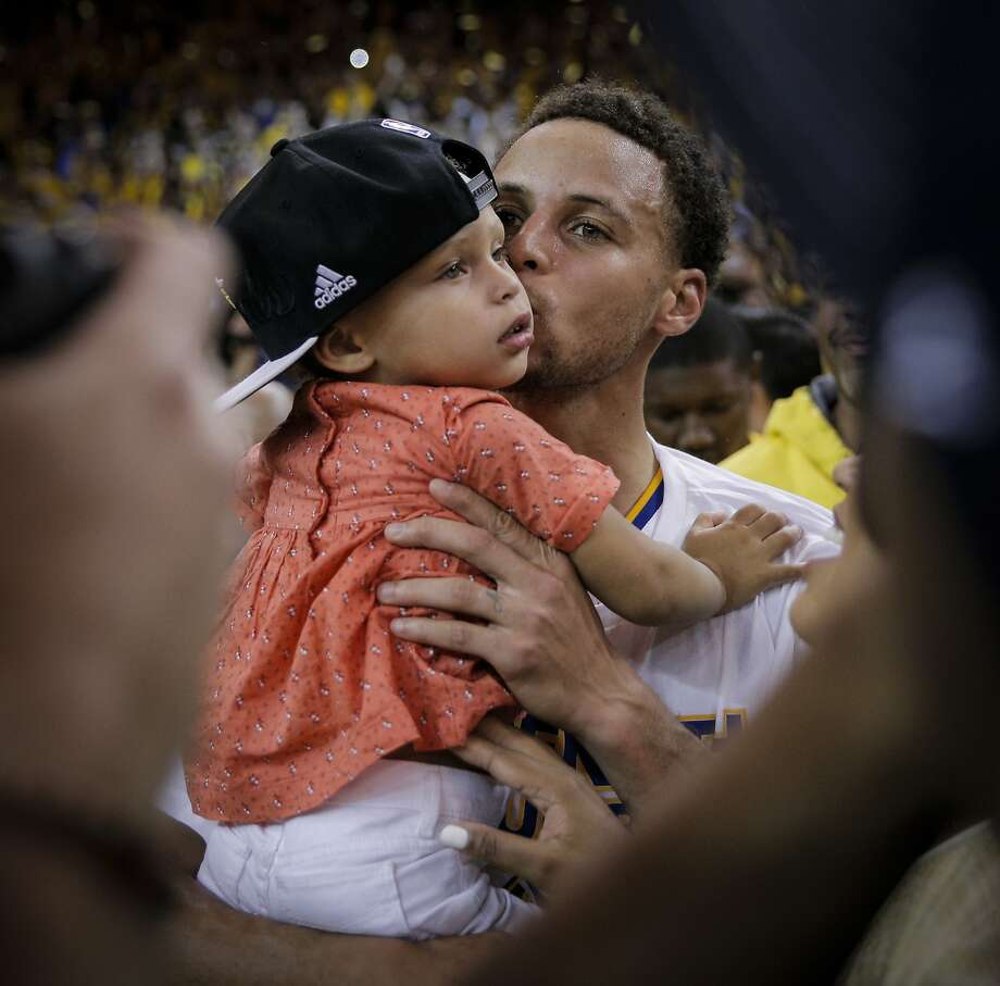 Golden State Warriors' Stephen Curry kisses his daughter, Riley, after the Warrior's 104 to 90 victory over the Houston Rockets during Game 5 of the Western Conference Finals on Wednesday, May 27, 2015 in Oakland, Calif. Photo: Carlos Avila Gonzalez, The Chronicle