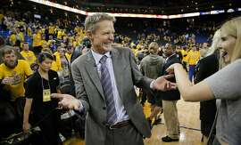 Golden State Warriors' Coach Steve Kerr celebrates after his team's 104 to 90 victory over the Houston Rockets after Game 5 of the Western Conference Finals on Wednesday, May 27, 2015 in Oakland, Calif.