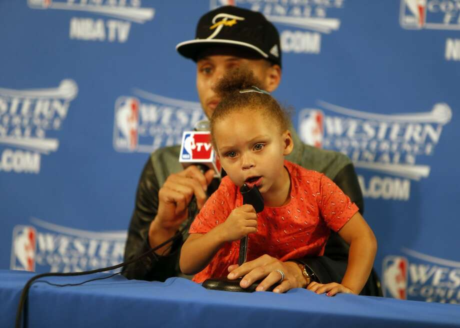 4840deee7dfb Golden State Warriors  Stephen Curry speaks to the media as his daughter  Riley plays after