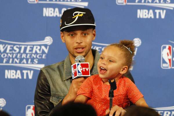 Stephen Curry and his daughter, Riley Curry, in the post-game press conference on Wednesday, May 27, 2015 in Oakland, Calif.