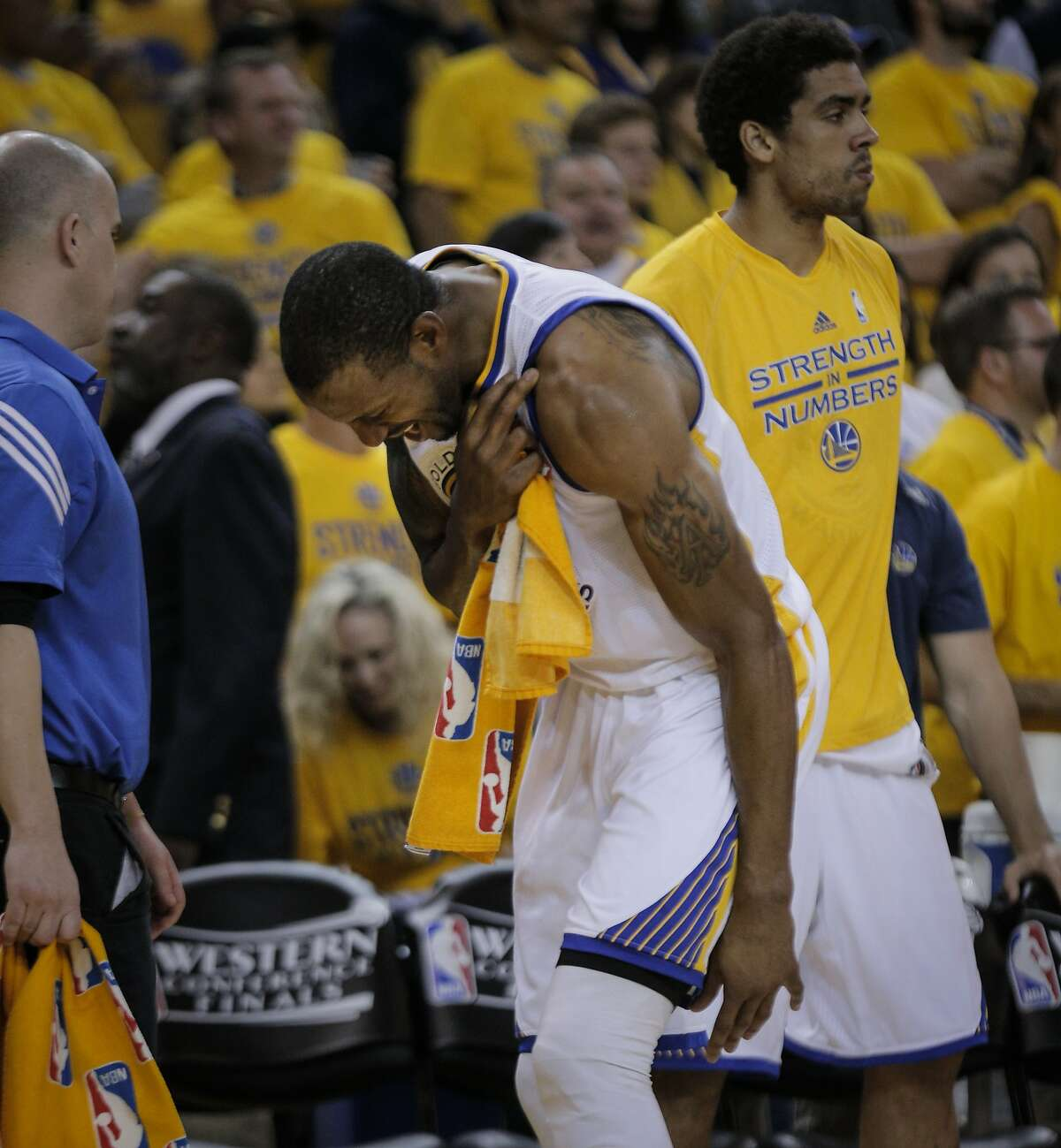 Golden State Warriors' Andre Iguodala holds his shoulder after being injured in the fourth period during Game 5 of the Western Conference Finals on Wednesday, May 27, 2015 in Oakland, Calif.