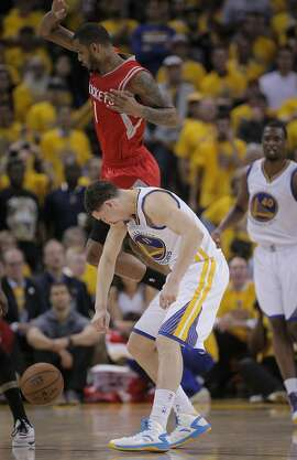 Houston Rockets' Trevor Ariza knees Golden State Warriors' Klay Thompson in the head in the fourth period during Game 5 of the Western Conference Finals on Wednesday, May 27, 2015 in Oakland, Calif.