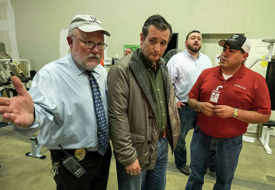 Hays County Judge Bert Cobbs, left, Sen. Ted Cruz, center, and San Marcos mayor Daniel Guerrero, right, leave after a news conference in San Marcos, Texas, Wednesday, May 27, 2015. (Rodolfo Gonzalez/Austin American-Statesman via AP)  AUSTIN CHRONICLE OUT, COMMUNITY IMPACT OUT, INTERNET AND TV MUST CREDIT PHOTOGRAPHER AND STATESMAN.COM, MAGS OUT Photo: Rodolfo Gonzalez, AP / Austin American-Statesman