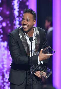 Santos accepts his award at the 2015 Billboard Latin Music Awards in April. He beat out Enrique Iglesias and Juan Gabriel, among others, as top Latin artist. Photo: Rodrigo Varela /Getty Images / 2015 Getty Images
