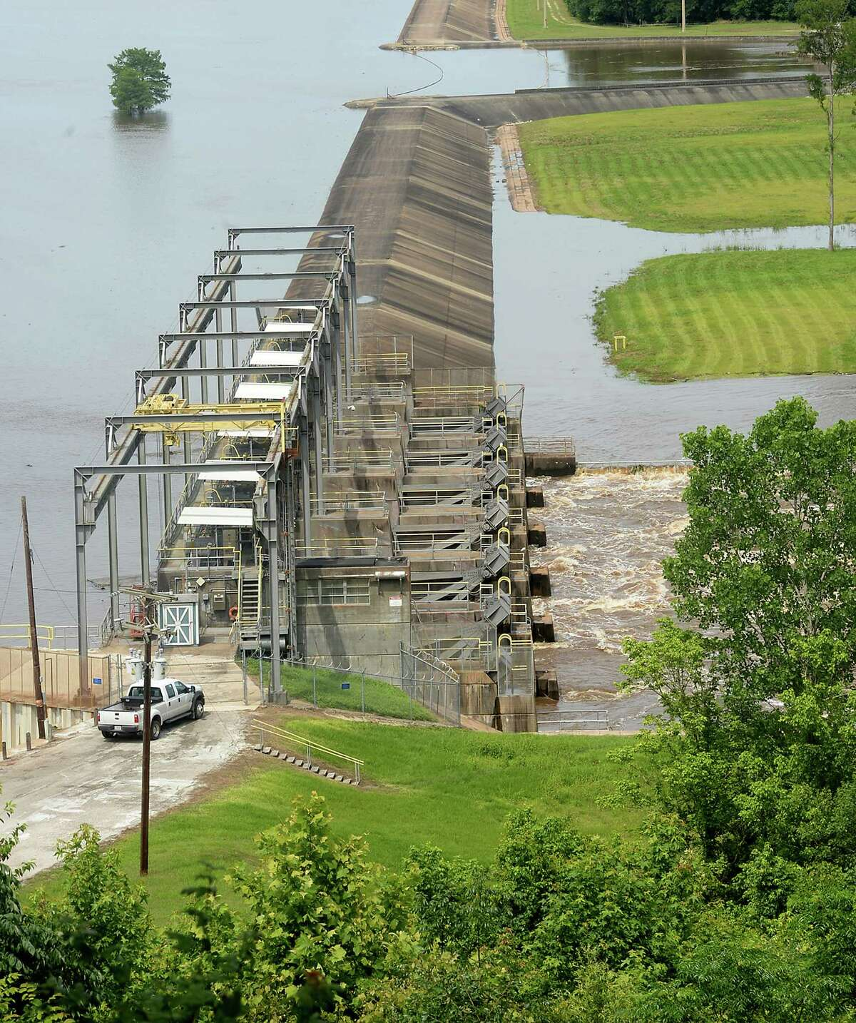 The gates of the Town Bluff dam on Steinhagen Lake in Tyler County were opened to relieve water levels, which added water to the already swollen Neches River running south of the dam. The river level currently stands at 71 1/2 feet, and is expected to rise another foot by Wednesday night. Photo taken Wednesday, May 27, 2015 Kim Brent/The Enterprise