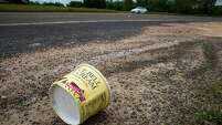 Is this any way to treat a legend? A container for Blue Bell homemade vanilla ice cream litters the side of Texas State Highway 105   in Brenham.
