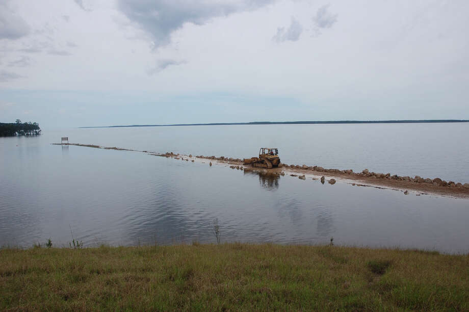 Tractor work on the levy at Sam Rayburn spillway May 27th photo by Jeff Reedy
