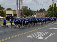 Traffic on Central Avenue in Albany, NY, is held up for the Law Enforcement Torch Run on Thursday, May 28, 2015. (Skip Dickstein/Times Union)
