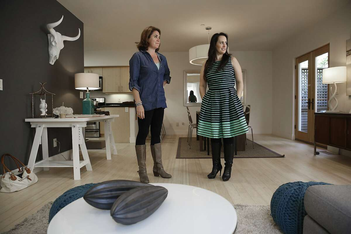 Home buyer Susan Giddens (right) views a home with her agent Linnette Edwards (left) which she recently bought in Oakland, California, on Wednesday, May 27, 2015. Giddens toured the property two weeks ago for ten minutes before she made an offer, with this being her first visit back to the property.