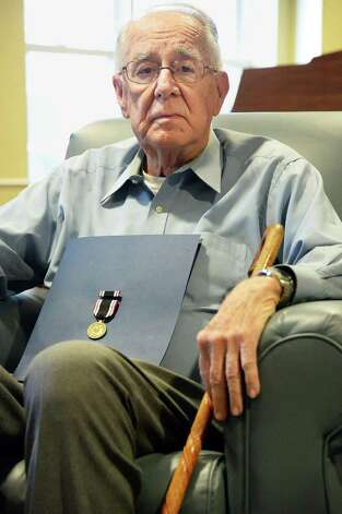 WWII Army veteran Francis Minewith the POW Medal during a ceremony in his honor at Judson Meadows Assisted Living Community Wednesday May 27, 2015, in Glenville NY.  (John Carl D'Annibale / Times Union) Photo: John Carl D'Annibale / 00031983A