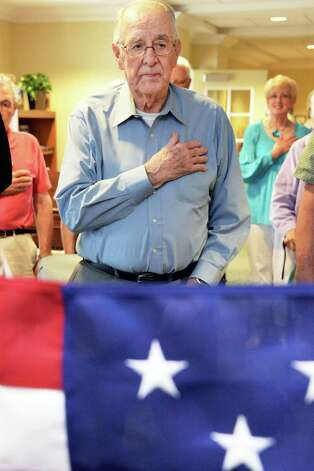 WWII Army veteran Francis Miner,says the Pledge of Alligence during a ceremony to award him the POW Medal at Judson Meadows Assisted Living Community Wednesday May 27, 2015, in Glenville NY.  (John Carl D'Annibale / Times Union) Photo: John Carl D'Annibale / 00031983A