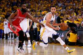 OAKLAND, CA - MAY 27:  Stephen Curry #30 of the Golden State Warriors drives on James Harden #13 of the Houston Rockets in the second half during game five of the Western Conference Finals of the 2015 NBA Playoffs at ORACLE Arena on May 27, 2015 in Oakland, California. NOTE TO USER: User expressly acknowledges and agrees that, by downloading and or using this photograph, user is consenting to the terms and conditions of Getty Images License Agreement.  (Photo by Ezra Shaw/Getty Images)