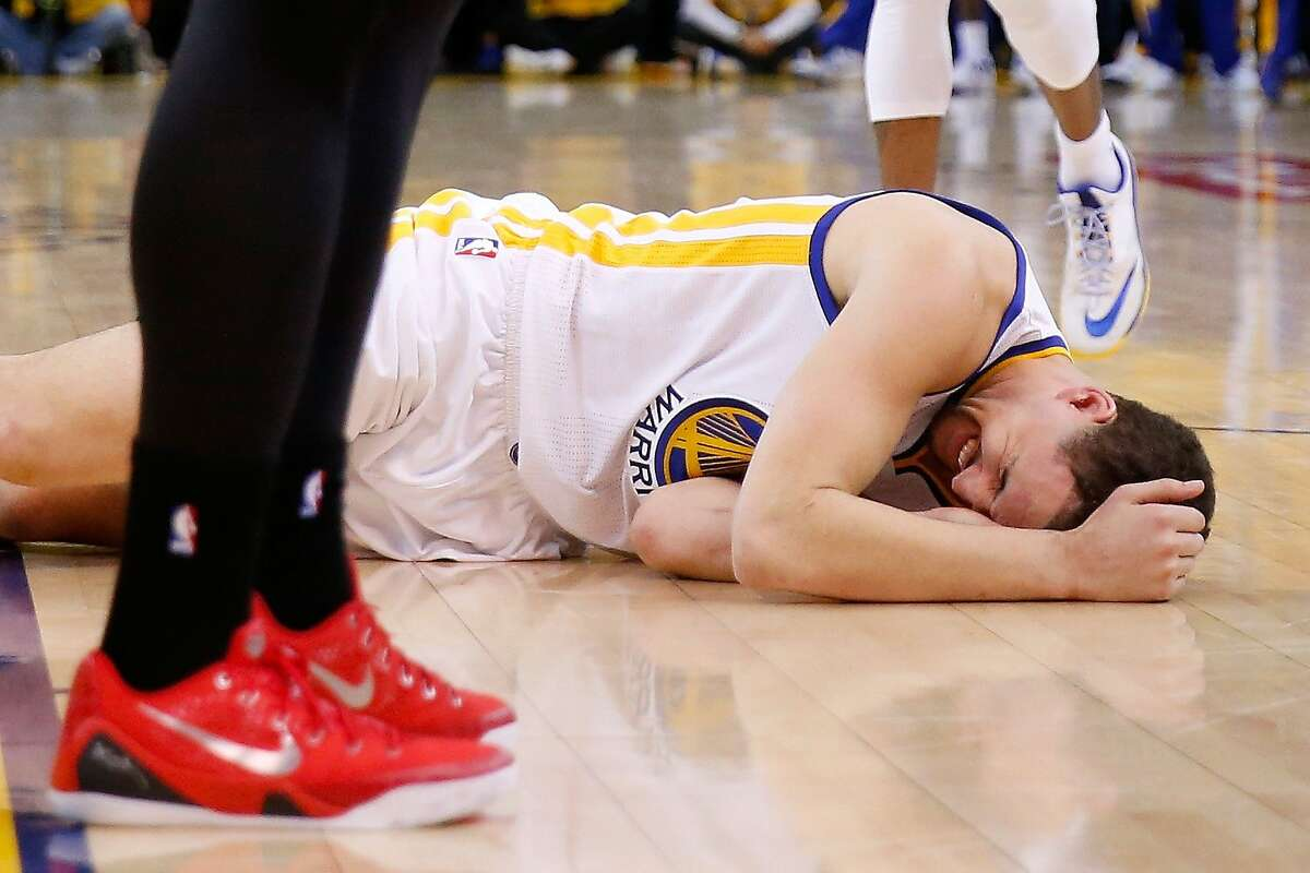OAKLAND, CA - MAY 27: Klay Thompson #11 of the Golden State Warriors is injured in the fourth quarter against the Houston Rockets during game five of the Western Conference Finals of the 2015 NBA Playoffs at ORACLE Arena on May 27, 2015 in Oakland, California. NOTE TO USER: User expressly acknowledges and agrees that, by downloading and or using this photograph, user is consenting to the terms and conditions of Getty Images License Agreement. (Photo by Ezra Shaw/Getty Images)