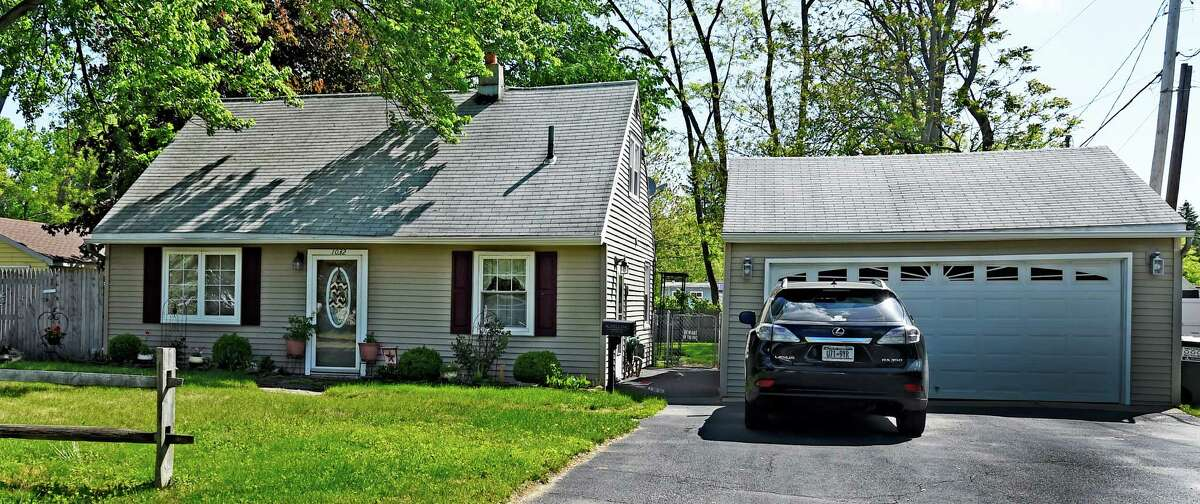 At 1,248 square feet with little ornamentation and the telltale long, steep roof, the house at 1032 Spry Lane, Schenectady is a perfect example of a Cape. It is for sale for $144,900. (Skip Dickstein/Times Union)