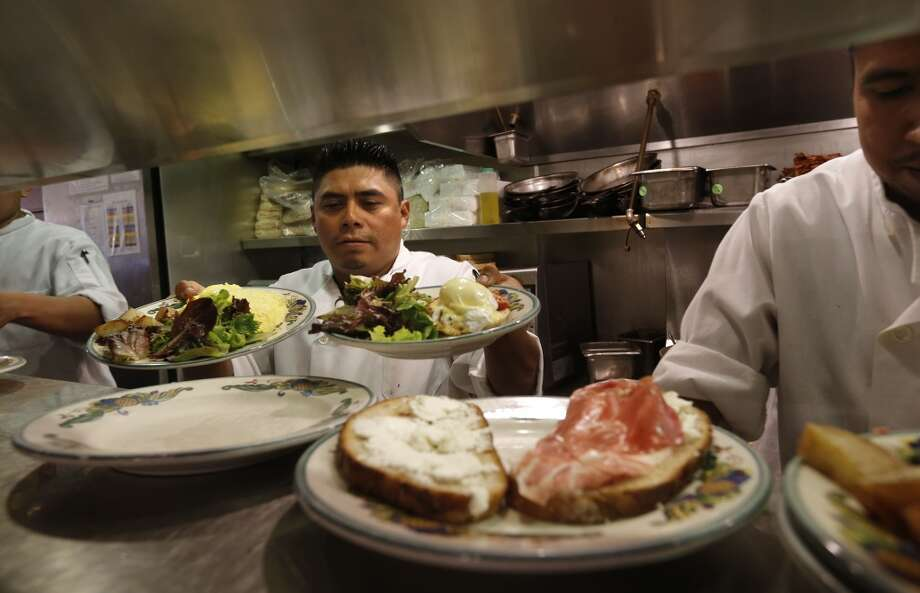 Cook Carlos Cauich prepares orders at Zazie restaurant, in San Francisco, Calif., on Wednesday Aug. 27, 2014. Photo: Michael Macor, The Chronicle